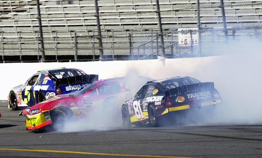 . NASCAR race car driver Martin Truex Jr.\'s, (81) Chevrolet crashes into Paul Wolfe\'s Dodge during the Hershey\'s Kisses 300 Monday,  Feb. 16, 2004 at the Daytona International Speedway in Daytona Beach, Fla. Dale Earnhardt Jr. won the race. (AP Photo/Paul Kizzle)