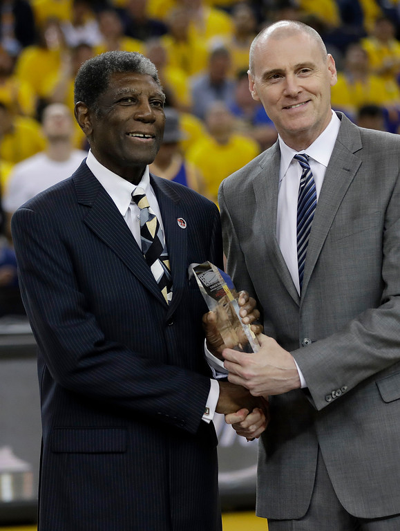 . Former Golden State Warriors head coach Al Attles, left, accepts the NBA Coaches Association\'s Chuck Daly Lifetime Achievement Award from Dallas Mavericks head coach Rick Carlisle during the first half of Game 2 of basketball\'s NBA Finals between the Warriors and the Cleveland Cavaliers in Oakland, Calif., Sunday, June 4, 2017. (AP Photo/Marcio Jose Sanchez)