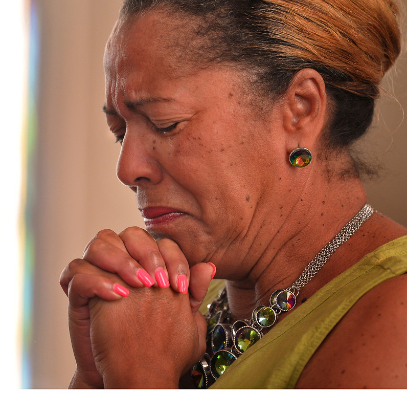 . Jean Hawkins participates in a prayer of forgiveness during a service at the Mount Moriah Baptist Church in Spartanburg, S.C. on Saturday, June 20, 2015, in honor of those shot and killed in a Charleston, S.C. church earlier in the week. (Tim Kimzey/Spartanburg Herald-Journal via AP)