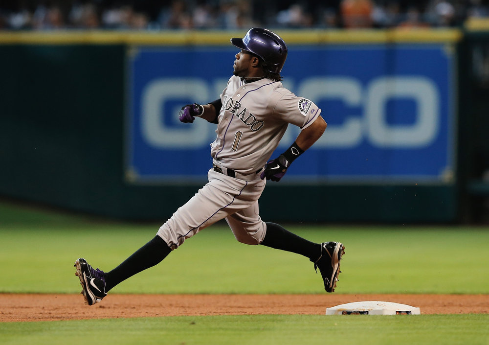. Eric Young Jr. #1  of the Colorado Rockies runs to second base after hitting a double during the first inning against the Houston Astros at Minute Maid Park on May 27, 2013 in Houston, Texas. (Photo by Scott Halleran/Getty Images)