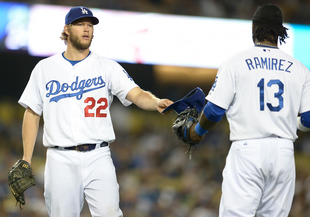 . Clayton Kershaw hands a cap to Hanley Ramirez after Ramirez committed a throwing error in the 7th inning that cost Kershaw a perfect game.  Kershaw would go on to throw a no hitter. The Dodgers defeated the Colorado Rockies 8-0 at Dodger Stadium in Los Angeles, CA. 6/18/2014(Photo by John McCoy Daily News)