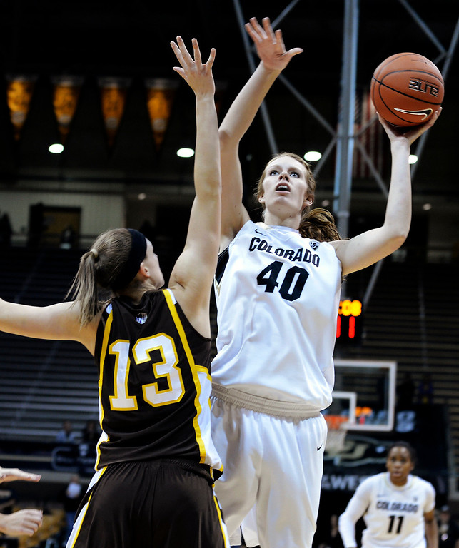 . Colorado\'s Rachel Hargis (40) shoots over Wyoming\'s Ashley Sickles during their NCAA college basketball game, Wednesday, Nov. 28, 2012, in Boulder, Colo. (AP Photo/The Daily Camera, Jeremy Papasso)