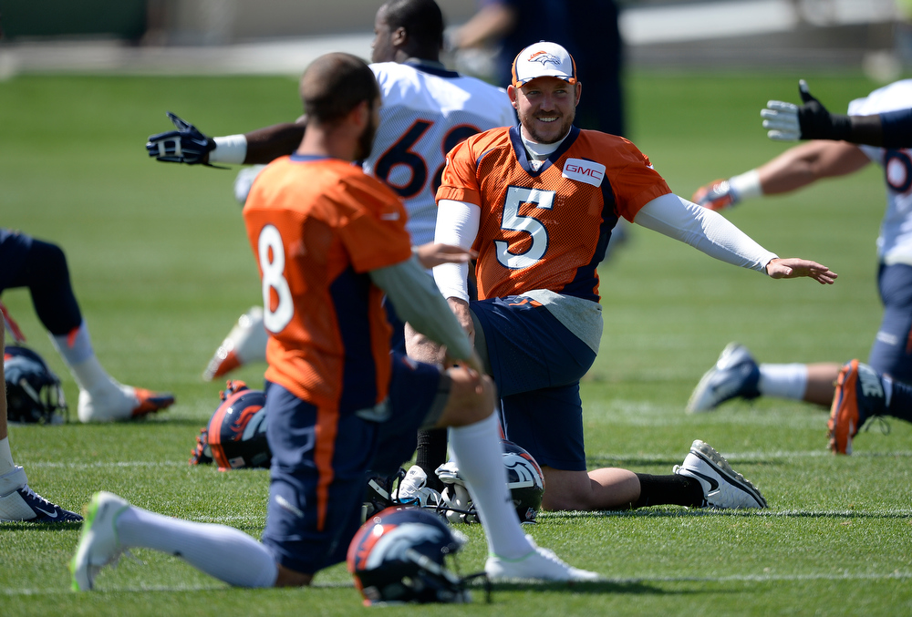 . Denver Broncos kicker Mitch Ewald (8) and Denver Broncos kicker Matt Prater (5) stretch before practice August 25, 2014 at Dove Valley. Matt Prater will be suspended for the first four games of the season for violating the NFL\'s substance abuse policy. (Photo by John Leyba/The Denver Post)