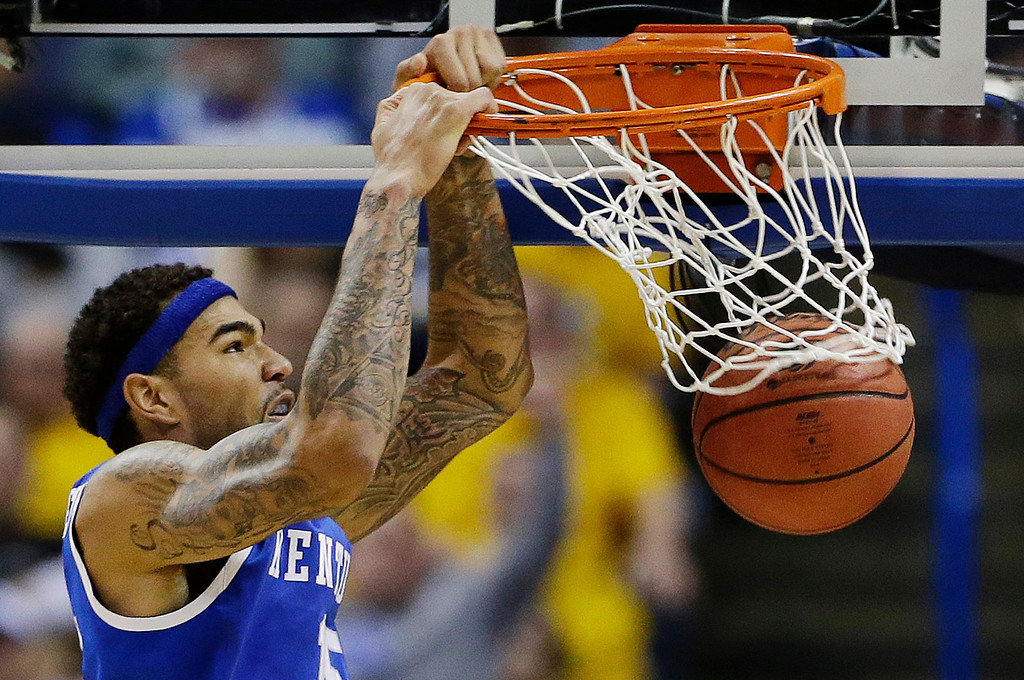 . Kentucky forward Willie Cauley-Stein (15) dunks against Wichita State during the second half of a third-round game of the NCAA college basketball tournament Sunday, March 23, 2014, in St. Louis. (AP Photo/Jeff Roberson)