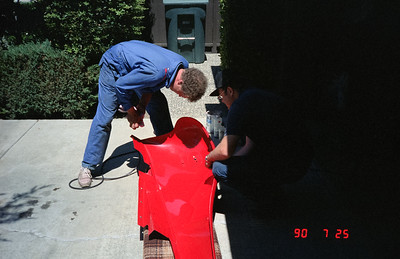 MGTD painter putting on final touches to fender.