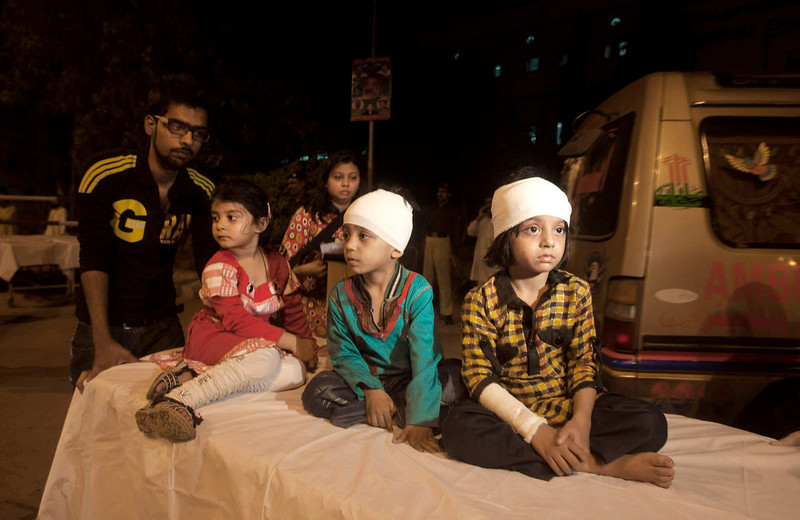 . Pakistani children, who were slightly injured in a bomb blast, are brought to a hospital in Karachi, Pakistan, Sunday, March 3, 2013. Pakistani officials say a bomb blast has killed dozens of people in a neighborhood dominated by Shiite Muslims in the southern city of Karachi. (AP Photo/Shakil Adil)