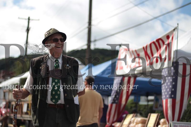 Amid the bustle strolls Evans City Oktoberfest's annual announcer Rick Reifenstein. (photo by Caleb Harshberger)