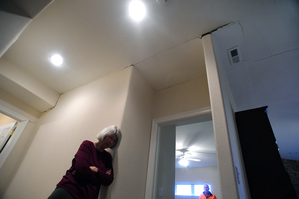 . Homeowners Sherry, left, and Denny Cripps look at the cracks in the ceilings in the downstairs area of  their home in in Broadmoor Bluffs on April 11, 2016 in Colorado Springs, Colorado.  The Cripps are among 200 homeowners who have applied for federal bailouts because their home is being eaten up by collapsing expansive soil that is part of an ancient and massive landslide area.  Their home has cracked walls, uneven floors and is literally sliding down the mountain.  It is a problem that city officials have known about since the mid-1990\'s when city planners approved developments on what geologists have called some of the most unstable geology on the front range.  (Photo by Helen H. Richardson/The Denver Post)