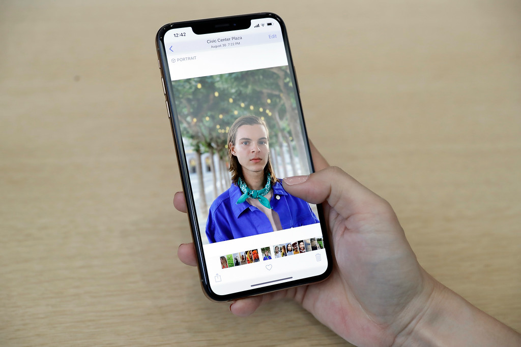 . A photograph is displayed on a iPhone XS Max during an event to announce new products at Apple Headquarters Wednesday, Sept. 12, 2018, in Cupertino, Calif. (AP Photo/Marcio Jose Sanchez)