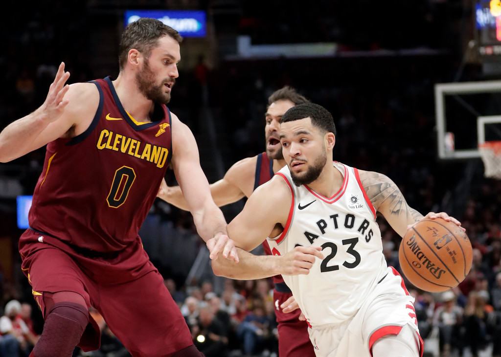 . Toronto Raptors\' Fred VanVleet (23) drives against Cleveland Cavaliers\' Kevin Love (0) during the first half of an NBA basketball game Wednesday, March 21, 2018, in Cleveland. (AP Photo/Tony Dejak)