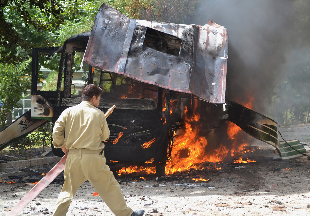 . Pakistani fire fighters extinguish a burning university bus after a bomb blast in Quetta, the capital of Baluchistan province, on June 15, 2013. At least 23 people were killed after militants blew up a bus carrying female students in Pakistan\'s troubled southwest and later targeted the hospital treating survivors, as a gun battle with insurgents continued, officials said.  AFP PHOTO/ Banaras  KHAN/AFP/Getty Images