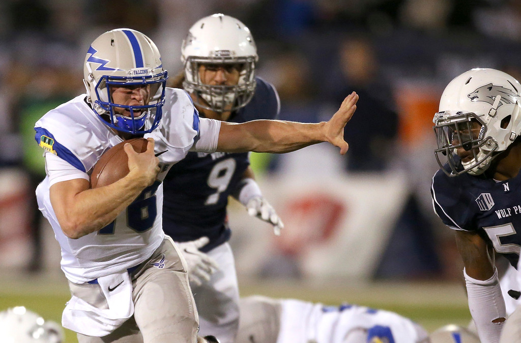 . Air Force\'s Karson Roberts (16) runs through the Nevada defense during the second half of an NCAA college football game in Reno, Nev., on Saturday, Sept. 28, 2013. (AP Photo/Cathleen Allison)
