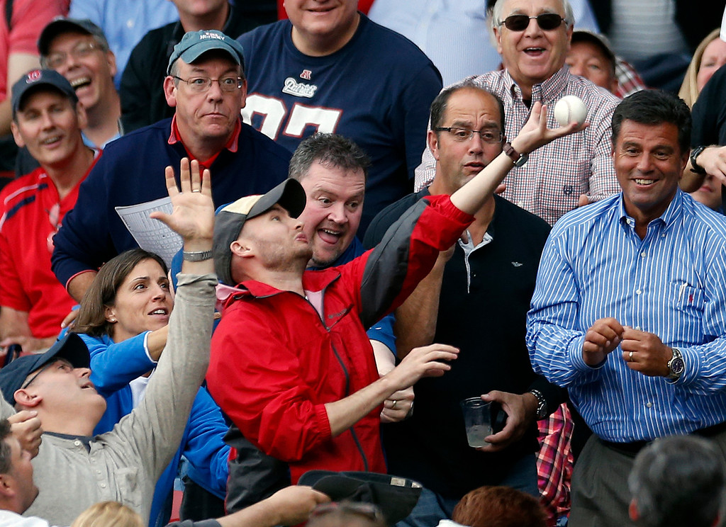 . Fans reach for a foul ball in the fifth inning in Game 1 of baseball\'s American League division series between the Boston Red Sox and the Tampa Bay Rays, Friday, Oct. 4, 2013, in Boston. (AP Photo/Michael Dwyer)
