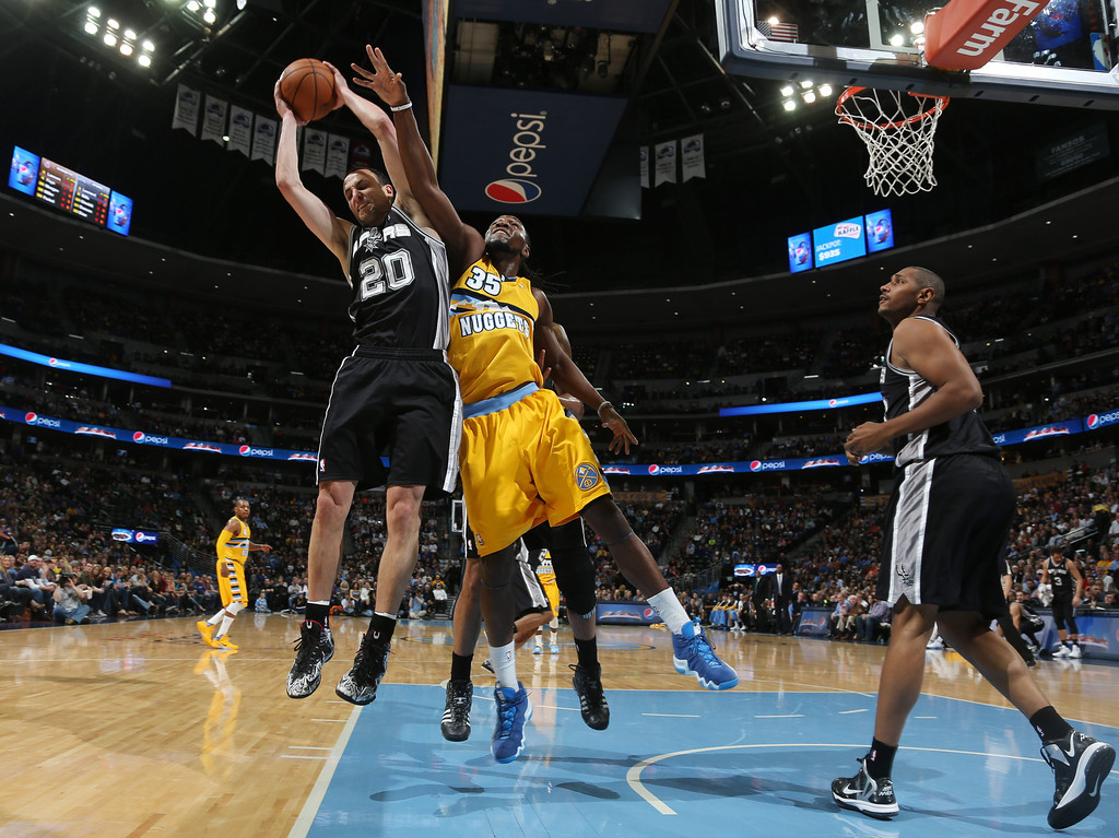 . From left, San Antonio Spurs guard Manu Ginobili (20), of Argentina, pulls in a rebound in front of Denver Nuggets forwards Kenneth Faried and Boris Diaw, of France, in the first quarter of an NBA basketball game in Denver, Friday, March 28, 2014. (AP Photo/David Zalubowski)