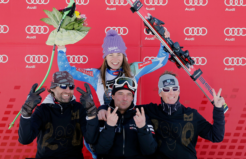 . Slovenia\'s Tina Maze, top center, celebrates on the podium with her team members after winning an alpine ski, women\'s World Cup downhill, in Garmisch-Partenkirchen, Germany, Saturday, March 2, 2013. (AP Photo/Marco Trovati)
