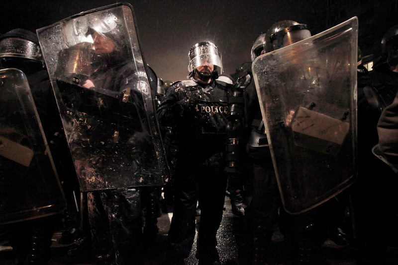 . Riot police form up after clashes with demonstrators after  a protest against high electricity prices in Sofia, on late Tuesday, Feb. 19, 2013.  Bulgaria\'s prime minister announced on Tuesday that the license held by a Czech company for power distribution in parts of the Balkan country will be revoked following protests against high electricity prices. (AP Photo/Valentina Petrova)
