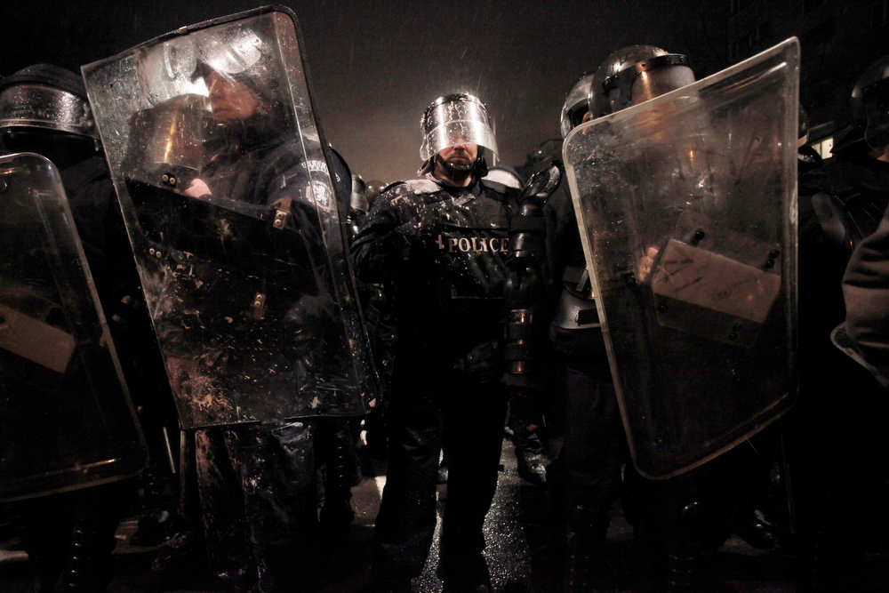 Description of . Riot police form up after clashes with demonstrators after  a protest against high electricity prices in Sofia, on late Tuesday, Feb. 19, 2013.  Bulgaria's prime minister announced on Tuesday that the license held by a Czech company for power distribution in parts of the Balkan country will be revoked following protests against high electricity prices. (AP Photo/Valentina Petrova)