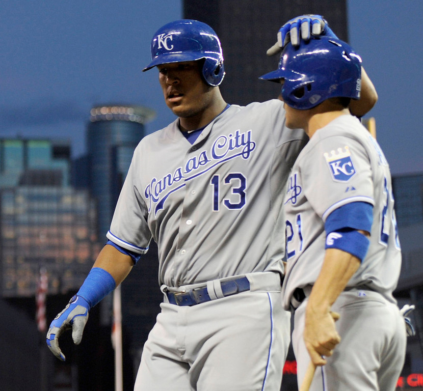 . Jamey Carroll #21 of the Kansas City Royals congratulates teammate Salvador Perez #13 on a two run home run against the Minnesota Twins during the fourth inning. (Photo by Hannah Foslien/Getty Images)