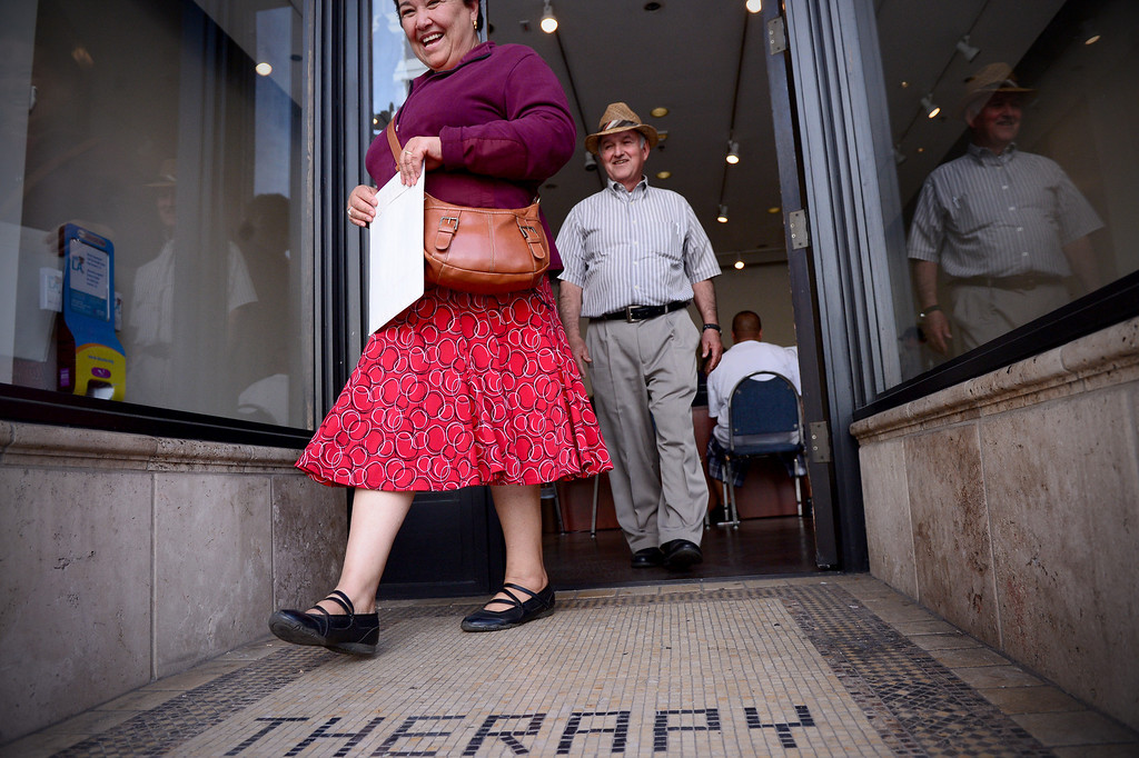 . Graciela and Francisco Alvarez, of Altadena, leave Cover LA Health Insurance Enrollment Shop in Paseo Colorado in Pasadena after getting help with Graciela\'s application for Covered California Thursday, February 20, 2014. Cover LA opened to help people sign up for health care insurance under the Affordable Care Act. Alvarez, who is retired and on Medicare, canceled his 57-year-old wife\'s insurance after applying in the exchange last November and has since found out his wife is not covered. (Photo by Sarah Reingewirtz/Pasadena Star-News)