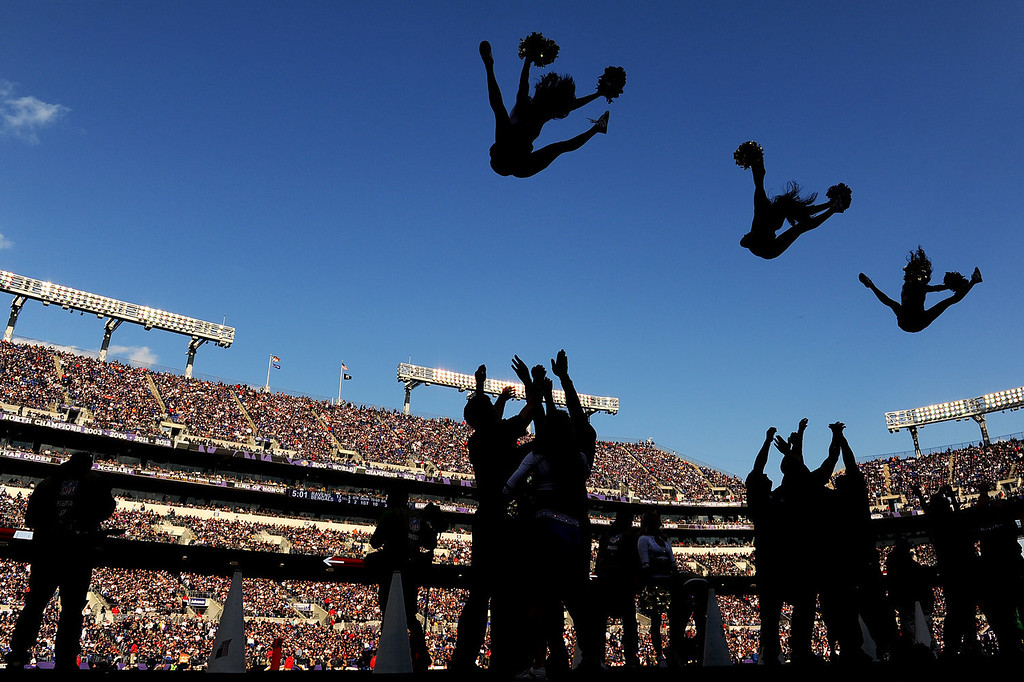. The Baltimore Ravens cheerleaders perform a stunt during a timeout of an NFL game against the Cincinnati Bengals at M&T Bank Stadium on November 10, 2013 in Baltimore, Maryland. The Baltimore Ravens won, 20-17, in overtime. (Photo by Patrick Smith/Getty Images)