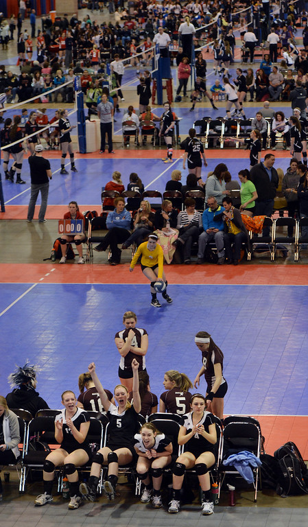. DENVER, CO. - MARCH 02: players cheer on the teammates from the bench during the  Colorado Crossroads National Qualifier volleyball tournament at the Colorado Convention Center in Denver, CO March 02, 2013. The event, held over two weekends,  is one of nine national tournaments that lead up to the USA Junior National Girls\' Volleyball Championships. Close to 700 teams will play on 89 courts through the weekend. (Photo By Craig F. Walker/The Denver Post)