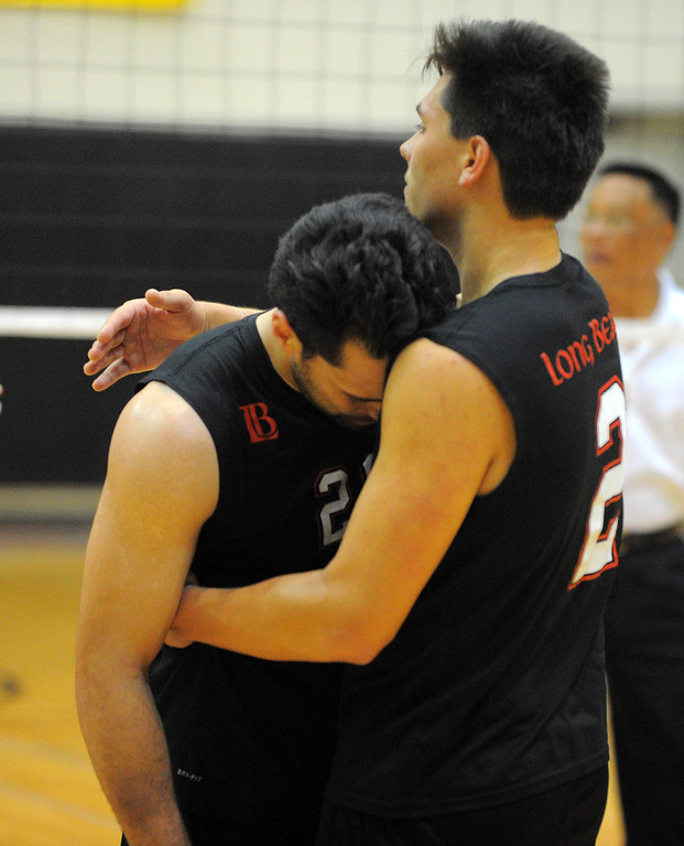 . LONG BEACH - 04/18/13 - (Photo: Scott Varley, Los Angeles Newspaper Group)  Long Beach City College vs Grossmont in the CCCAA State Volleyball semifinals. Grossmont won 3-1. LBCC\'s Greg Utupo, left, is consoled by Austin Arcala after the loss.