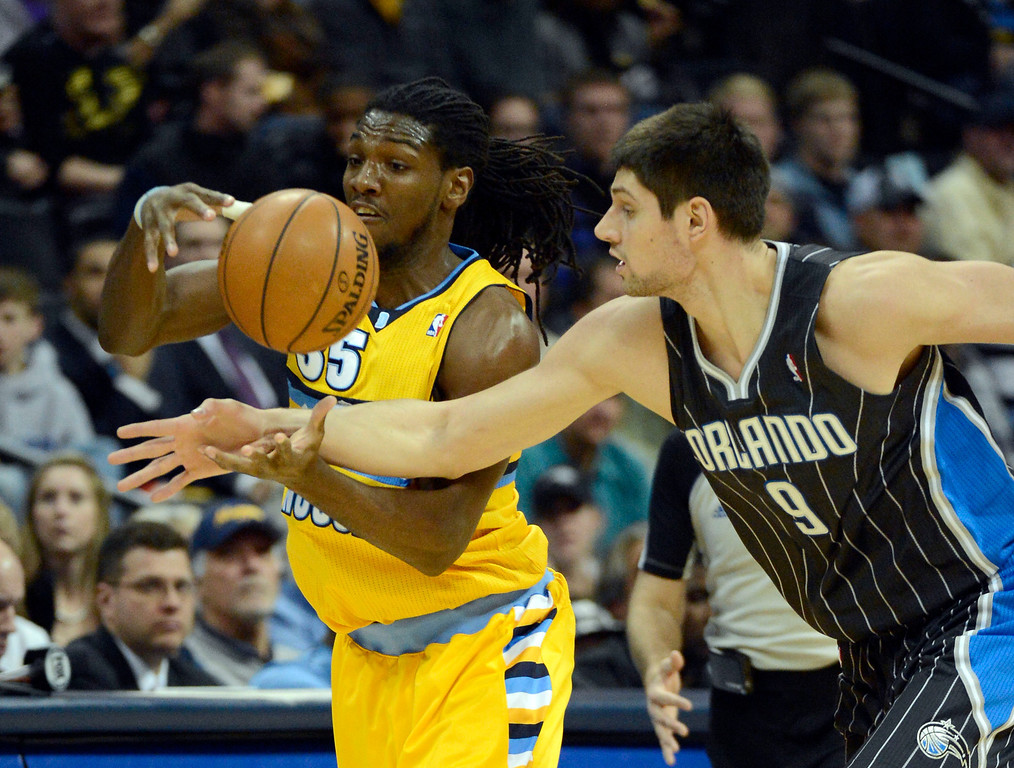 . Denver Nuggets small forward Kenneth Faried (35) steals the ball from Orlando Magic center Nikola Vucevic (9) during the first quarter Wednesday, January 9, 2013 at Pepsi Center. John Leyba, The Denver Post