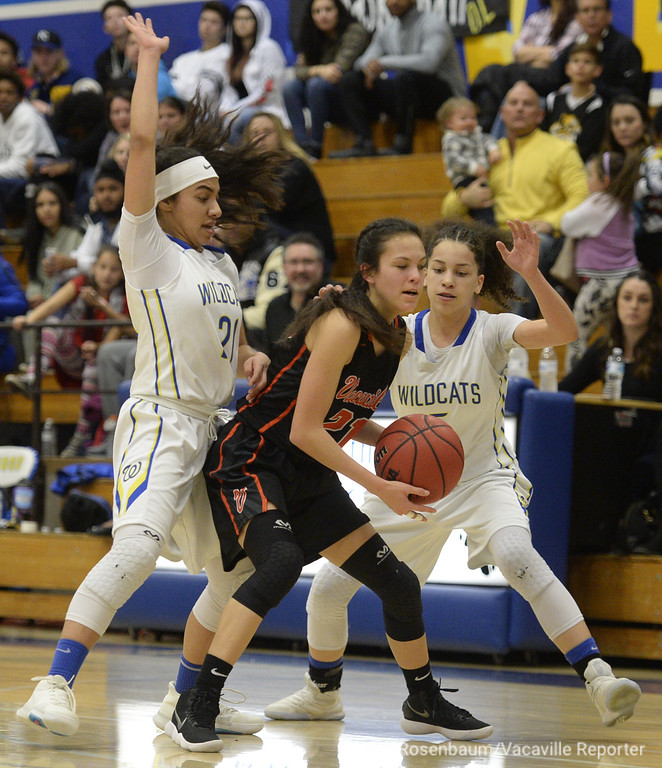 . Will C. Wood\'s Savannah Lopez (left) and Lexi Derf double team Vaca High\'s Audrey Valenzuela during the first quarter. Joel Rosenbaum -- The Reporter
