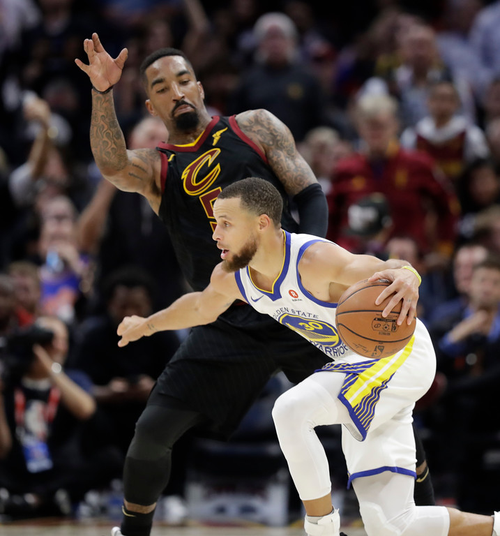 . Golden State Warriors\' Stephen Curry is defended by Cleveland Cavaliers\' JR Smith in the second half of Game 3 of basketball\'s NBA Finals, Wednesday, June 6, 2018, in Cleveland. (AP Photo/Tony Dejak)
