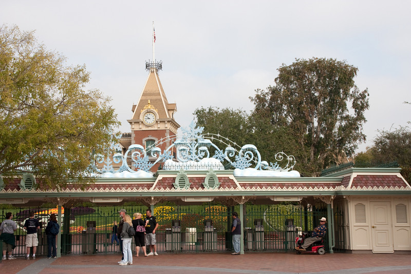 The entry gates to Disneyland, decorated for winter.