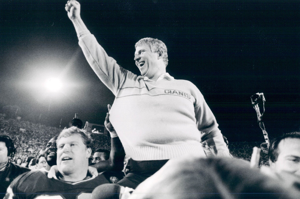 . 1987 - Bill Parcells is carried off the field at the end of game. (Jay Dickman/Special to the Denver Post)