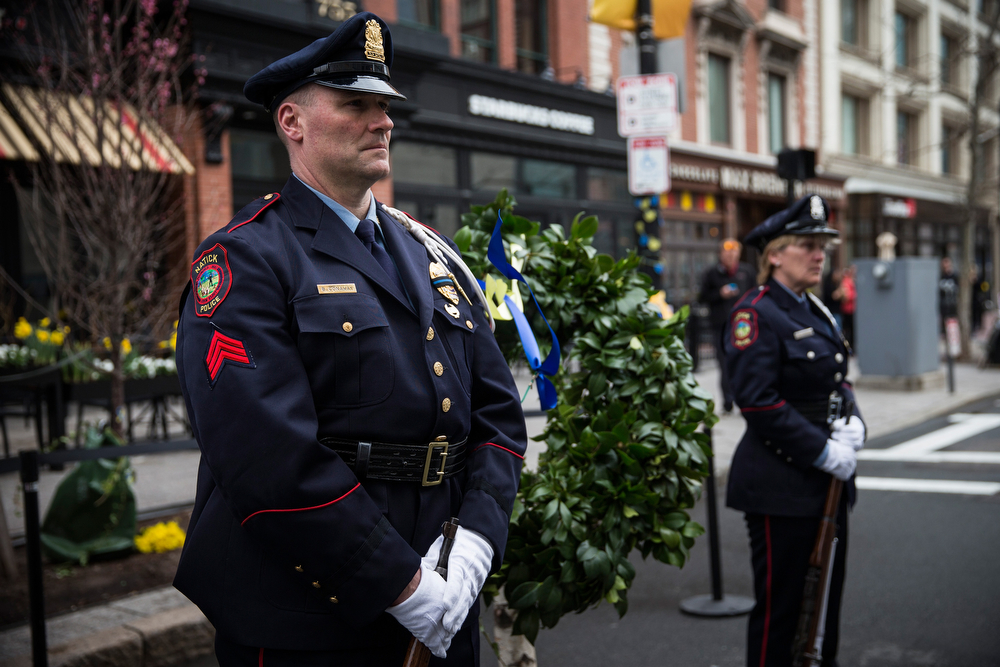 . Officers stand guard next to a wreath marking the one of the bombing sites on the one year anniversary of the 2013 Boston Marathon Bombing, on April 15, 2014 in Boston, Massachusetts. Last year, two pressure cooker bombs killed three and injured an estimated 264 others during the Boston marathon, on April 15, 2013. Neary says she was standing near the site of the bombing before it went off.  (Photo by Andrew Burton/Getty Images)