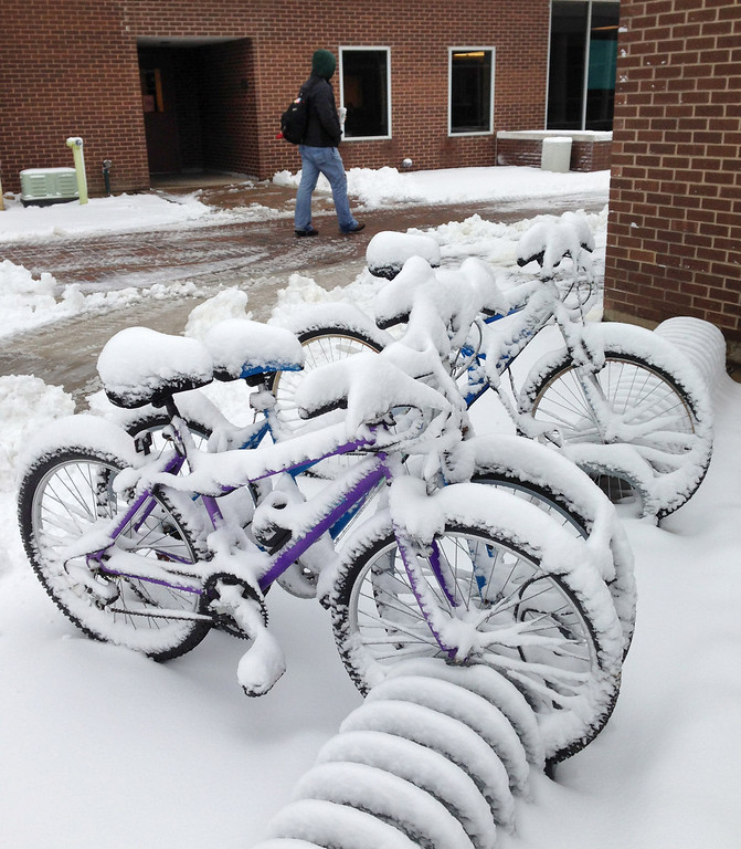. Bicycles are parked outside Hamilton Hall dorms are covered in snow after a storm passed the area, Wednesday, March 6, 2013 at Wright State University in Dayton, Ohio.   The National Weather Service has lifted winter storm warnings across Ohio, after a late-season storm dumped a half foot of snow or more on much of the state. (AP Photo/The Dayton Daily News, Ty Greenlees)