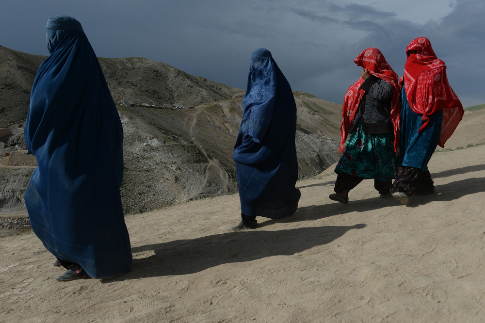 . Afghan villagers walk past at the scene in Argo district of Badakhshan province on May 3, 2014 after a massive landslide May 2 buried a village. Rescue teams abandoned the search for survivors May 3 after a landslide buried a hillside village in northern Afghanistan, killing at least 300 people under a fast-moving tide of rock and mud. (SHAH MARAI/AFP/Getty Images)