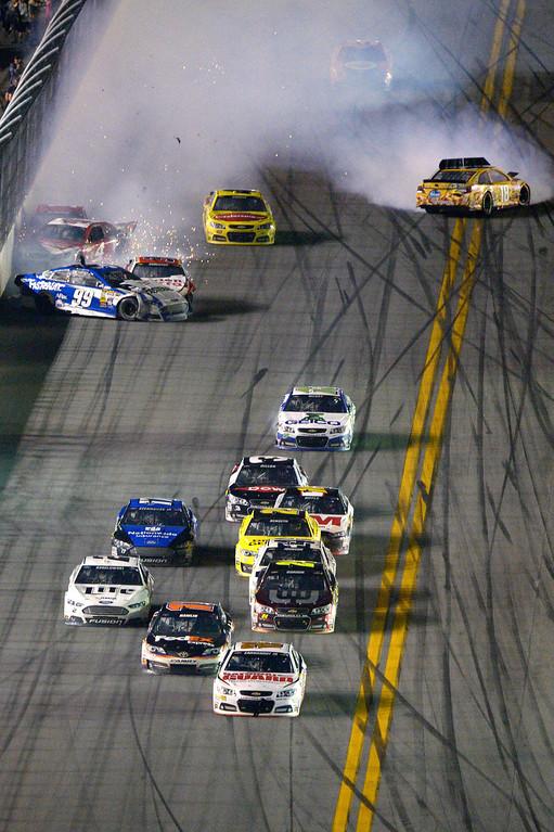 . Dale Earnhardt Jr. (88) escapes a final lap wreck and leads to the checkered flag to  win the NASCAR Daytona 500 auto race at Daytona International Speedway in Daytona Beach, Fla., Sunday, Feb. 23, 2014. (AP Photo/Phelan M. Ebenhack)