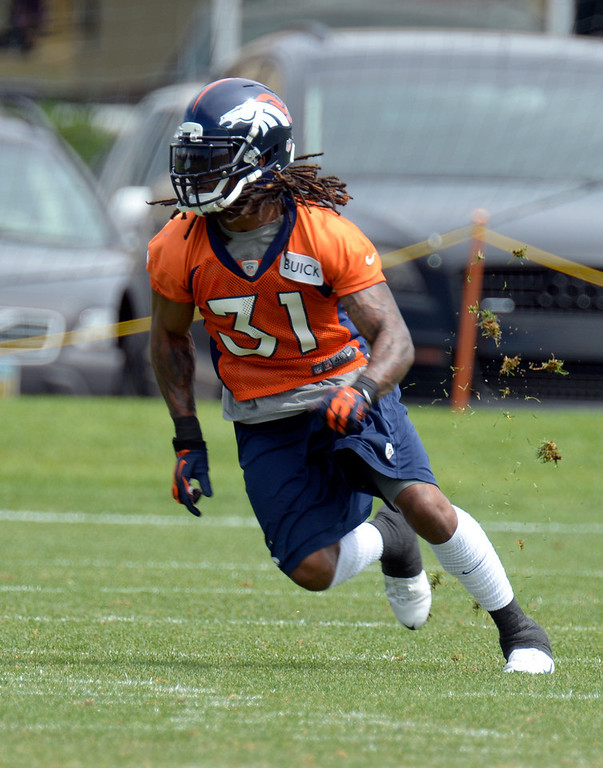 . Omar Bolden (31) CB of the Denver Broncos runs through drills kicking up grass during mini camp June 12, 2013 at Dove Valley. (Photo By John Leyba/The Denver Post)