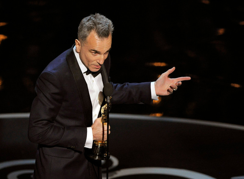 ". Daniel Day-Lewis accepts the award for best actor in a leading role for ""Lincoln\"" during the Oscars at the Dolby Theatre on Sunday Feb. 24, 2013, in Los Angeles.  (Photo by Chris Pizzello/Invision/AP)"