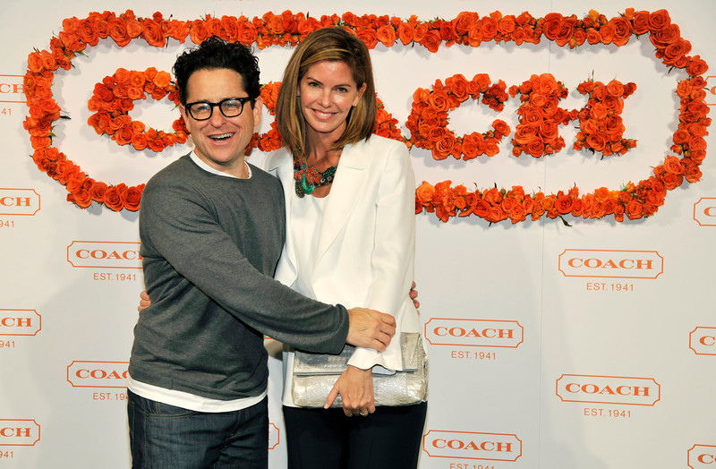. Hosts J.J. Abrams, left, and his wife Katie McGrath pose together at the 3rd Annual Coach Evening to Benefit Children\'s Defense Fun at Bad Robot on Wednesday, April 10, 2013 in Santa Monica, Calif. (Photo by Chris Pizzello/Invision/AP)