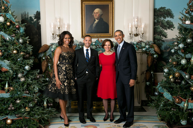 President Barack Obama and First Lady Michelle Obama greet Ms. Lyne Pitts (The Root) and Mr. Benjamin Bowens (Guest) during the Christmas holiday Press Reception #2 in the Diplomatic Reception Room of the White House, Dec. 15, 2015.  (Official White House Photo by Chuck Kennedy)  This photograph is provided by THE WHITE HOUSE as a courtesy and may be printed by the subject(s) in the photograph for personal use only. The photograph may not be manipulated in any way and may not otherwise be reproduced, disseminated or broadcast, without the written permission of the White House Photo Office. This photograph may not be used in any commercial or political materials, advertisements, emails, products, promotions that in any way suggests approval or endorsement of the President, the First Family, or the White House.