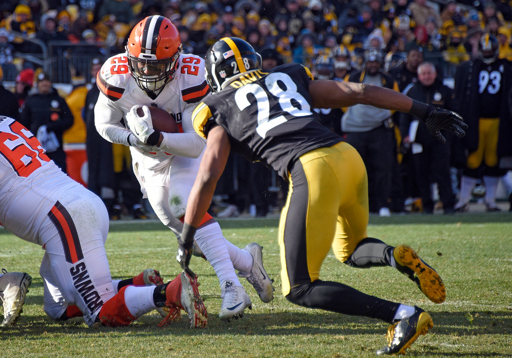 . Cleveland Browns running back Duke Johnson (29) scores with Pittsburgh Steelers strong safety Sean Davis (28) defending during the first half of an NFL football game in Pittsburgh, Sunday, Dec. 31, 2017. (AP Photo/Don Wright)