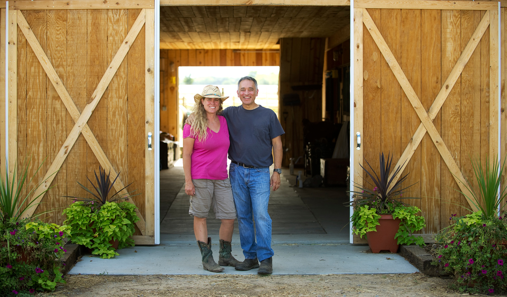 . Sara and  Lenny Martinelli  at their Three Leaf Concepts Farm in Lafayette on Wednesday, July 3, 2013.  They have horses, chickens, goats and are raising vegetables for their restaurants. The couple have three children. (Photo By Cyrus McCrimmon/The Denver Post)