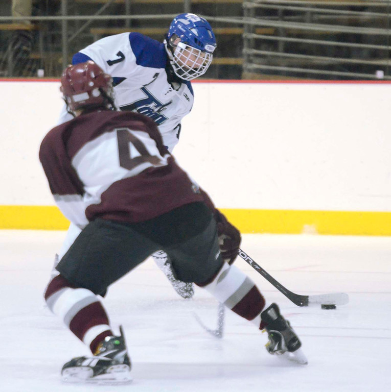 . Ed Burke - The Saratogian 12/07/13 Saratoga\'s Devin Coffey scores on this shot as St. Joseph\'s Brad Kaminski tries to block during Saturday\'s action in the Don Kauth Memorial Tournament at Saratoga Springs Ice Rink.