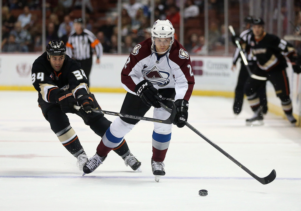 . Nick Holden #2 of the Colorado Avalanche is pursued by Daniel Winnik #34 of the Anaheim Ducks for the puck in the first period at Honda Center on September 22, 2013 in Anaheim, California. The Avalanche defeated the Ducks 2-1.  (Photo by Jeff Gross/Getty Images)