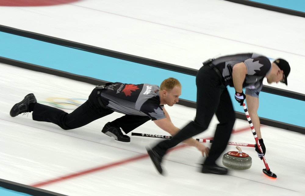 . Brad Jacobs (L-R) and Ryan Harnden of Canada at the final push at the Men\'s Gold medal match between Canada and Great Britain in the Curling competition in the Ice Cube Curling Center at the Sochi 2014 Olympic Games, Sochi, Russia, 21 February 2014.  EPA/Tobias Hase