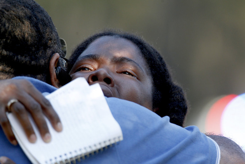 . Lone Star College Freshman Sheketa Taylor hugs her father Judson Gimblin after they found each other on the Lone Star Campus on January 22, 2013 in The Woodlands, Texas. According to reports, three people were injured during a shooting on the courtyard between the Library and cafeteria.  (Photo by Thomas B. Shea/Getty Images)