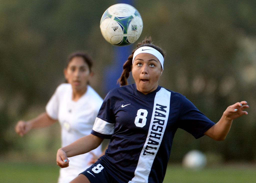 . Marshall\'s Itzel Del Villar (8) eyes the ball against Bishop Amat in the first half of a prep soccer match at Bishop Amat High School in La Puente, Calif., on Thursday, Jan. 9, 2014.Amat won 3-0. (Keith Birmingham Pasadena Star-News)