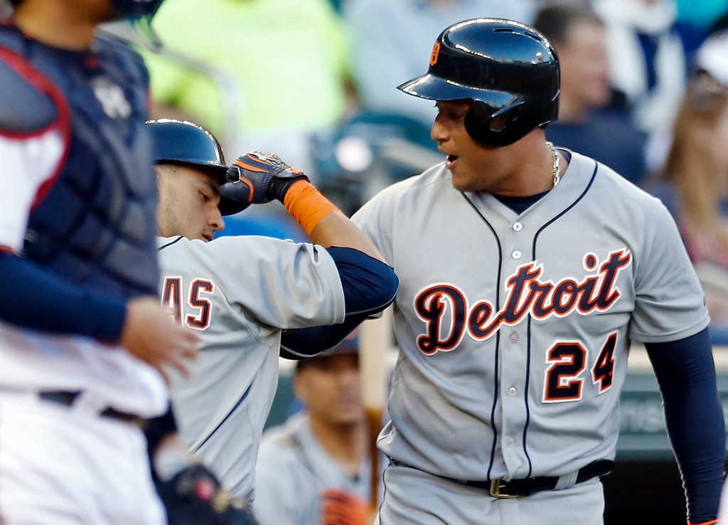 . Detroit Tigers� Jose Iglesias, is congratulated by Miguel Cabrera, right, after his solo home run off Minnesota Twins pitcher Tommy Milone in the first inning of a baseball game, Monday, April 27, 2015, in Minneapolis. (AP Photo/Jim Mone)