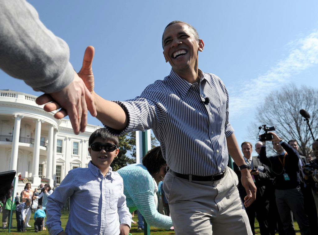 . President Barack Obama shakes hands during the annual Easter Egg Roll on the South Lawn of the White House in Washington, Monday, April 1, 2013. (AP Photo/Susan Walsh)