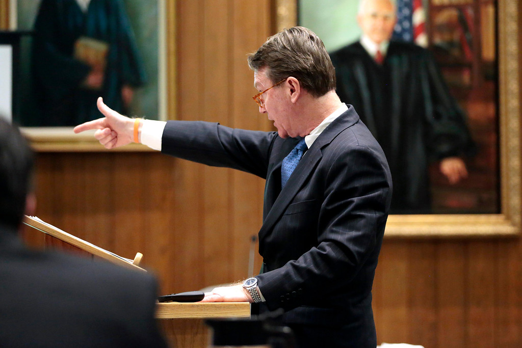 . Berkshire District Attorney David Capeless describes how the defendent allegedly shot his victims in his opening statement to the jury during the first day of the triple murder trial for Adam Lee Hall at the Springfield Courthouse. Monday, January 13, 2014. (AP Photo/Stephanie Zollshan, The Berkshire Eagle)