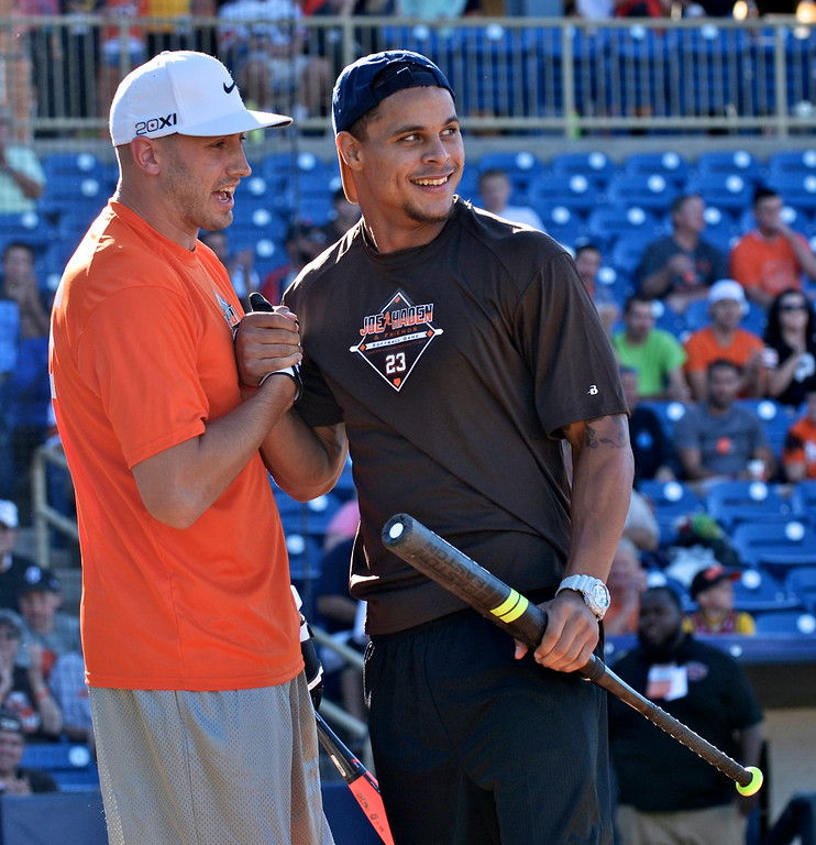 . Jeff Forman/JForman@News-Herald.com Brian Hoyer and Jordan Poyer celebrate their showing in the home run derby before the Joe Haden and Friends Softball Game July 17 at Classic Park.